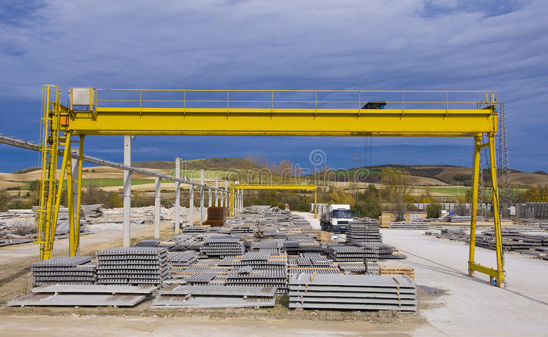 Yellow gantry crane. Construction elements under yellow gantry crane royalty free stock photo