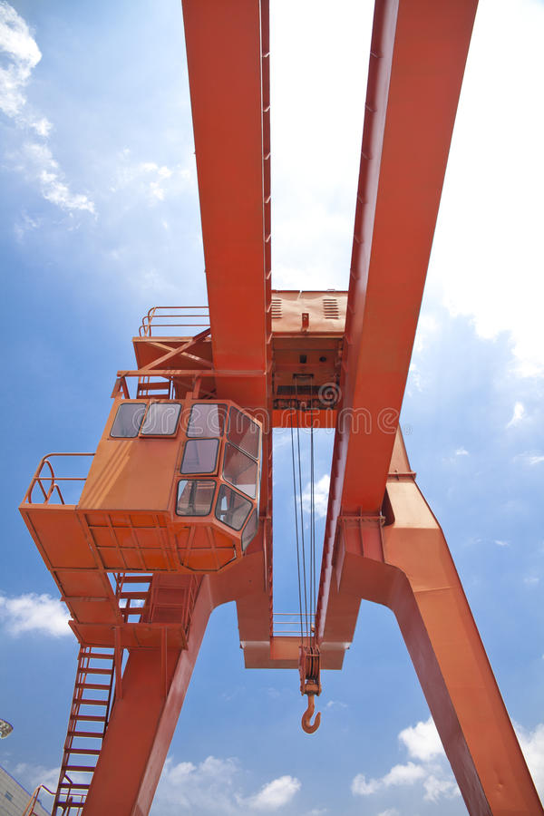 Yellow gantry crane. Gantry cranes partial close-up stock photo