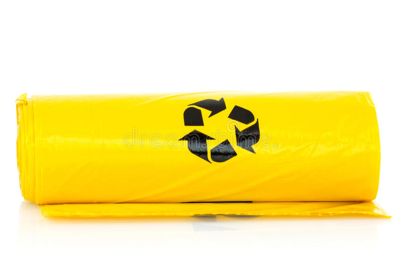 Yellow garbage bio bags royalty free stock photography
