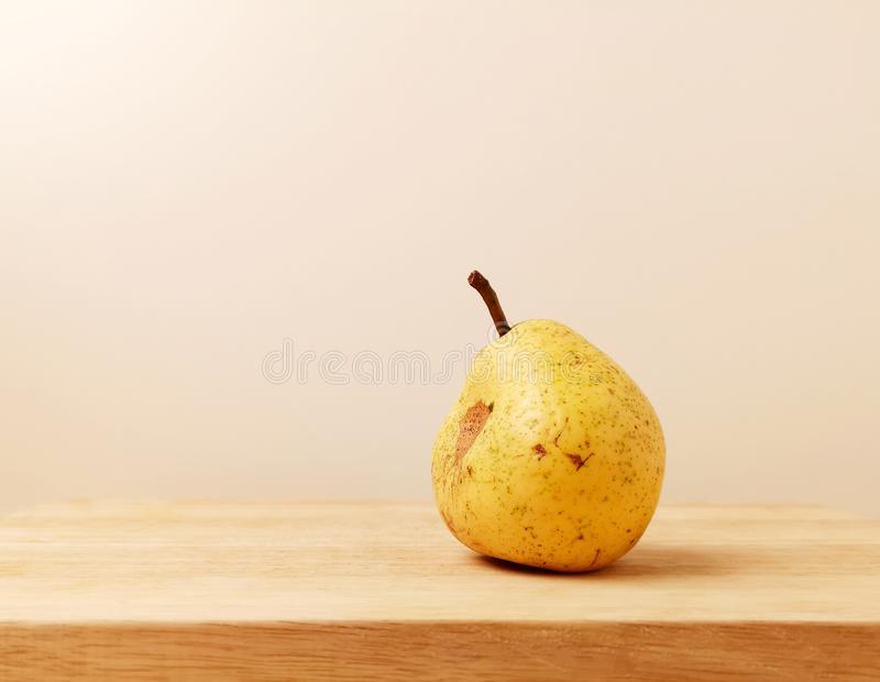 Yellow garden ripe ugly pear stock photography
