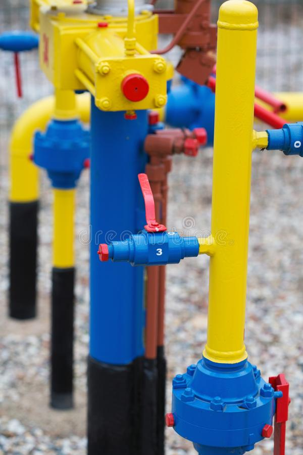 Yellow gas pipe with a crane. And valve stock images