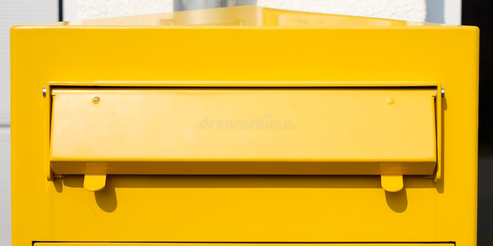Yellow German mailbox royalty free stock photography