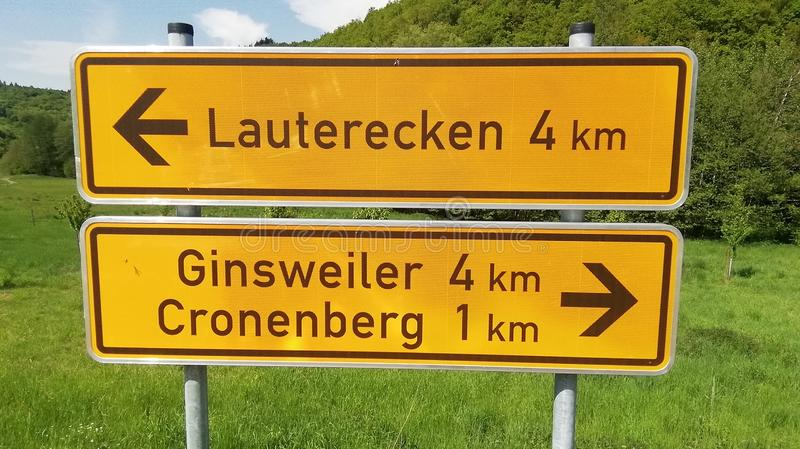 Yellow German traffic sign for directions. With km royalty free stock photos
