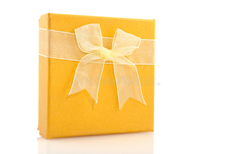 Yellow gift. Yellow luxury gift with ribbon and bow stock photo