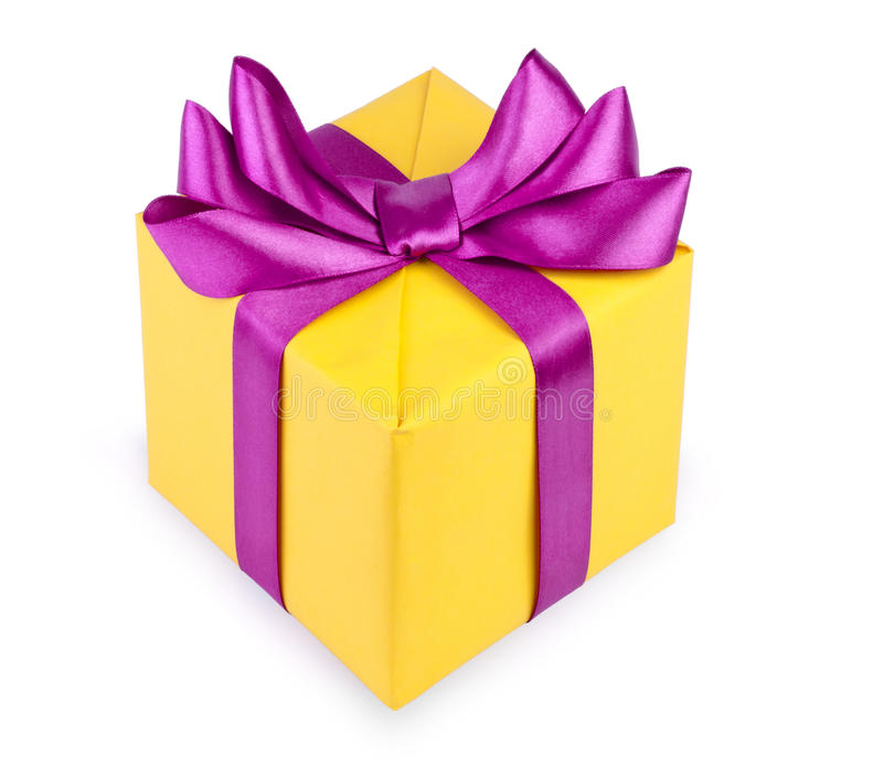 Yellow gift box with purple ribbon bow isolated stock photo