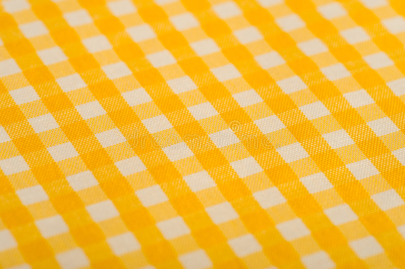 Yellow Gingham Background. Yellow Gingham or checked tablecloth background royalty free stock photo