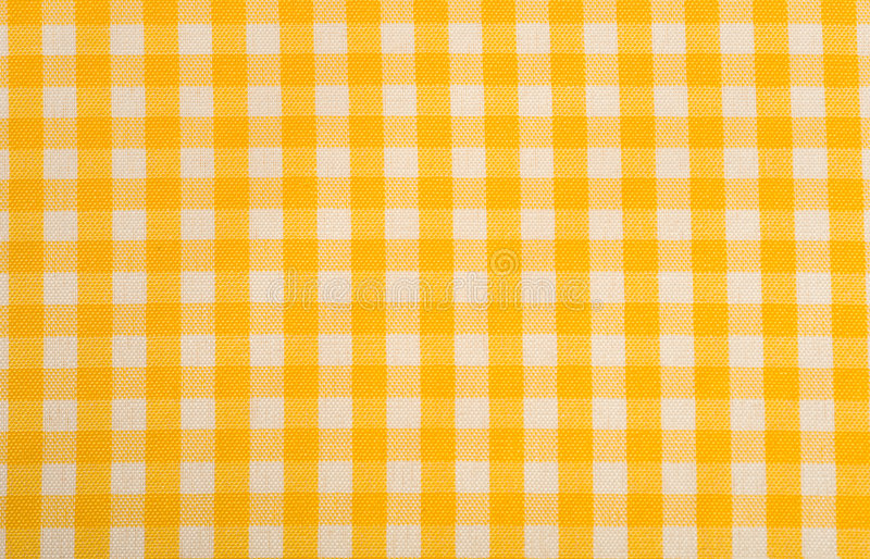 Yellow Gingham Background. Yellow Gingham or checked tablecloth background royalty free stock image
