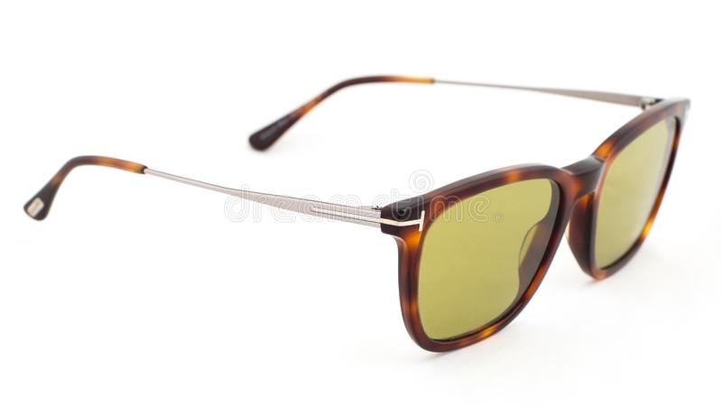 Yellow glasses with leopard print on a white background. Side view stock photo