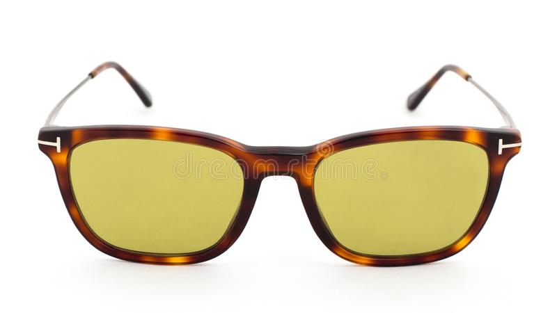 Yellow glasses with leopard print on a white background. Side view royalty free stock photos