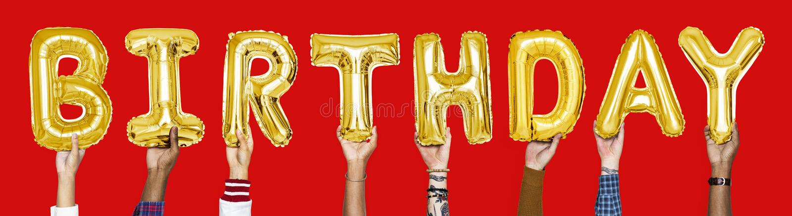 Yellow gold alphabet balloons forming the word birthday stock photos