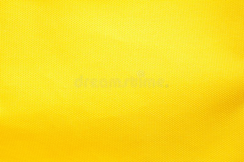 The Yellow of gold color fabric texture abstract background royalty free stock photo