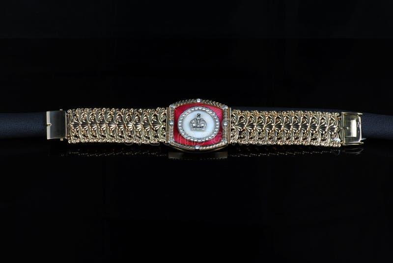 Yellow gold massive mens bracelet royalty free stock photography