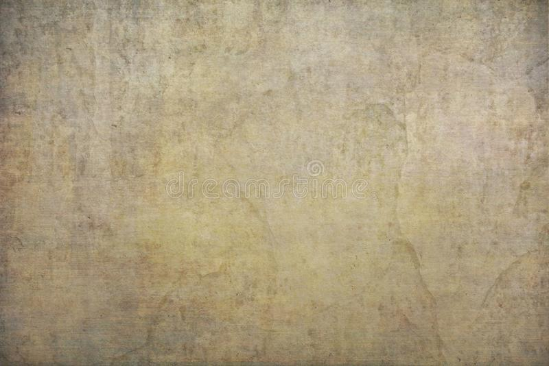 Yellow, gold painted canvas or muslin fabric cloth studio backdrop. Old grunge textures background with space for text royalty free stock images