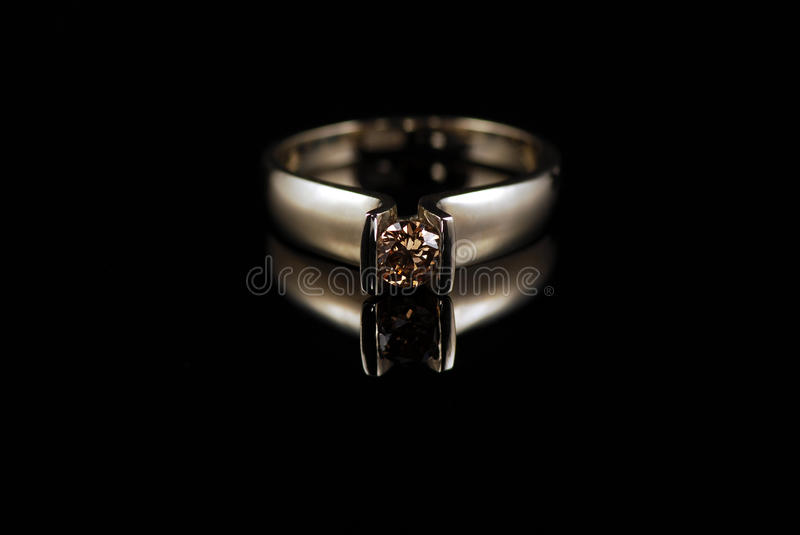 Yellow gold ring with cognac color diamond royalty free stock photo
