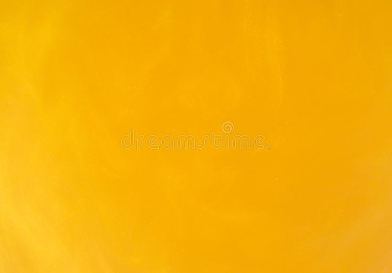 Yellow gold water texture. Golden ripples and waves. Yellow sand stock image