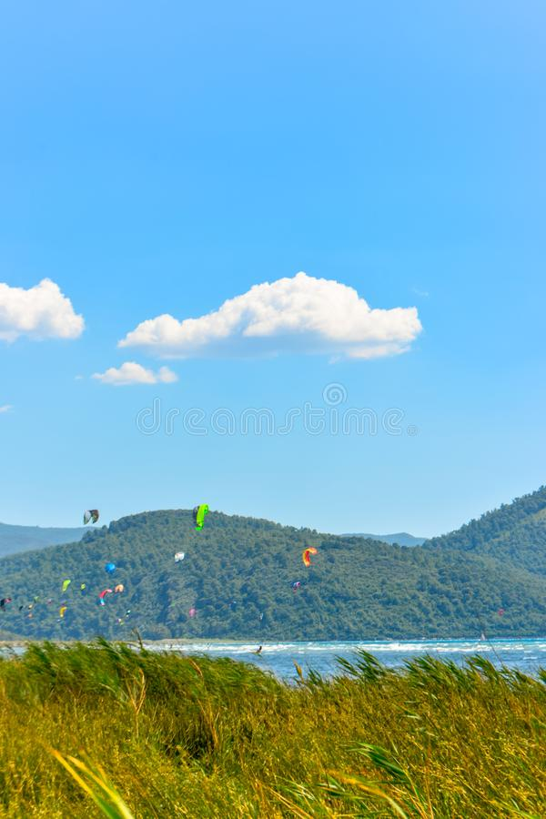 Yellow grasses, clouds, sky and kite board. stock photos