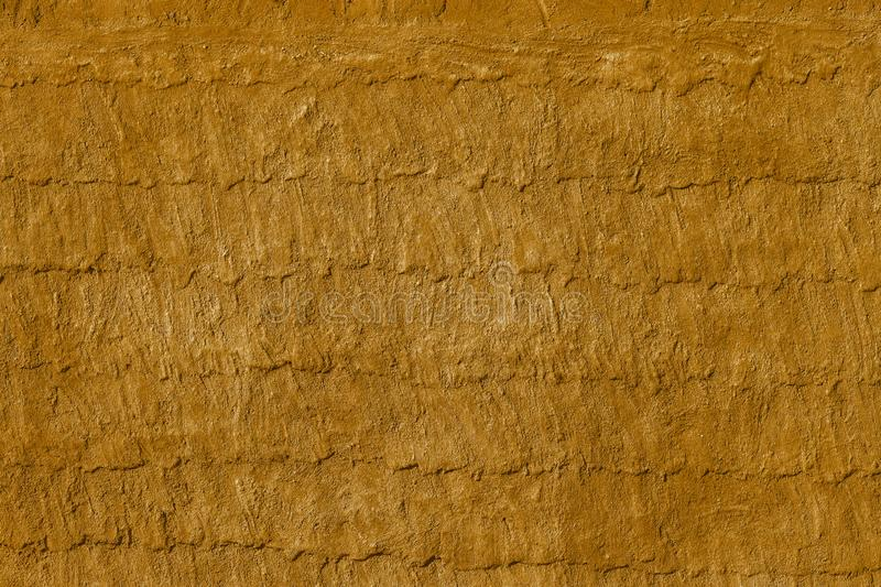 Yellow and Gray Dirty Plaster Wall, With Falling Off Flakes Of Paint. Rough Surface. royalty free stock photo