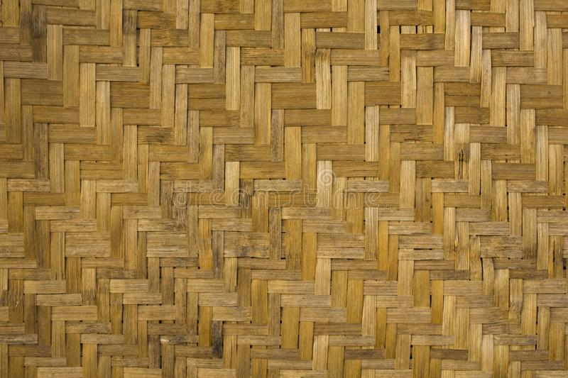 Yellow gray parquet pattern of dry bamboo. horizontal and vertical lines. natural surface texture royalty free stock images