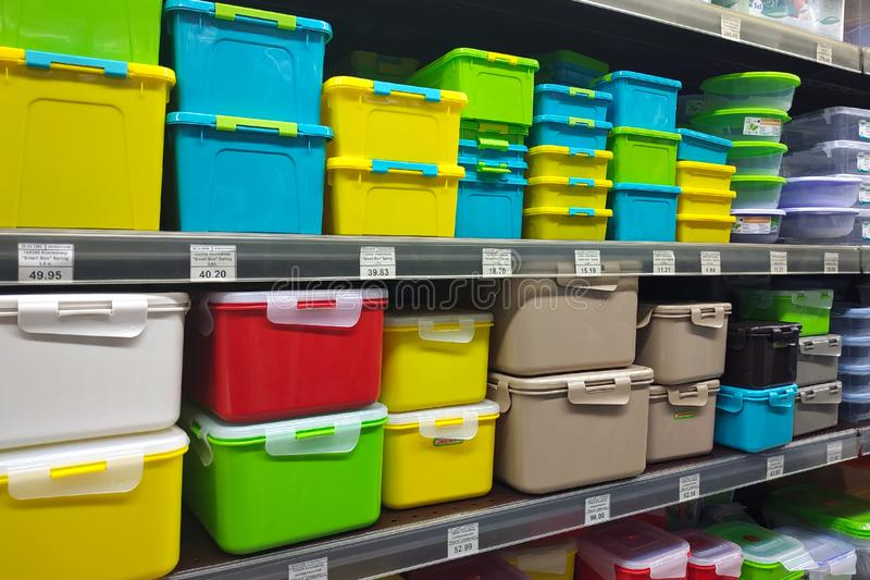 Yellow, green, blue plastic containers on store shelves. royalty free stock images