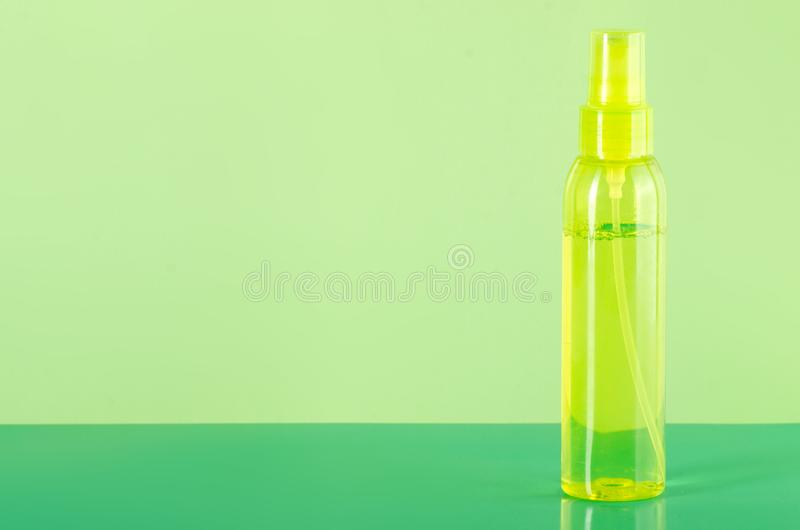 Yellow green bottle spray for body beauty stock images