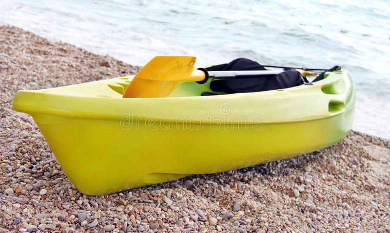 Yellow and green canoe royalty free stock image