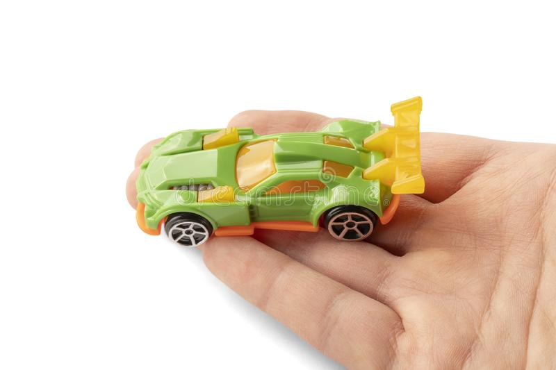 Yellow and green car toy in hand stock image