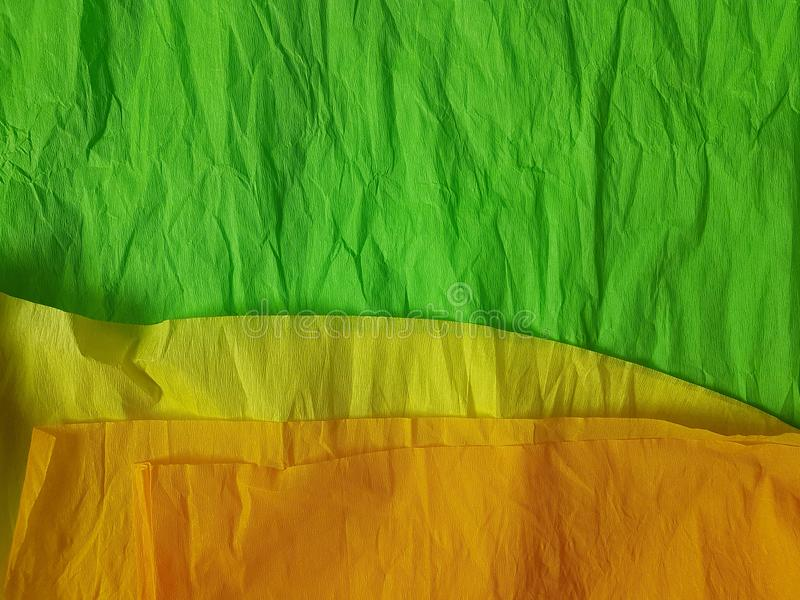 Green yellow paper background silk surface empty blank sheets vivid colors. Yellow green paper background silk surface empty blank sheets vivid colors wrapping stock images