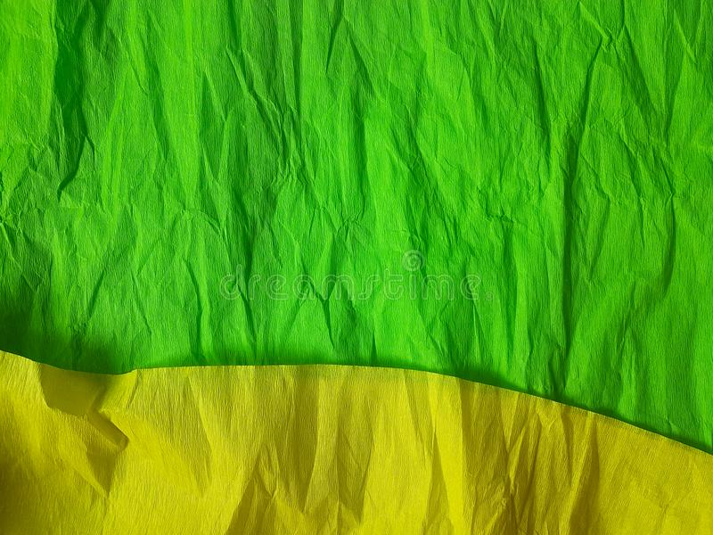 Green yellow paper background silk surface empty blank sheets vivid colors. Yellow green paper background silk surface empty blank sheets vivid colors wrapping stock photos