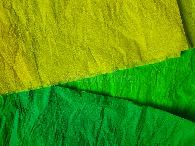 Yellow green paper background silk surface empty blank sheets vivid colors. Wrapping stock images
