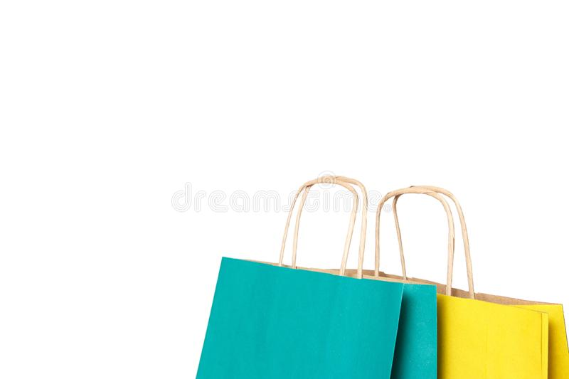Yellow and green paper shopping bags isolated royalty free stock photo
