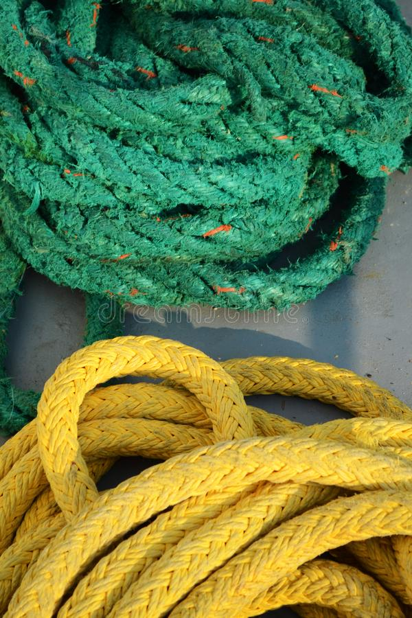 Yellow and green ropes. Used to tie ship to pier stock photography