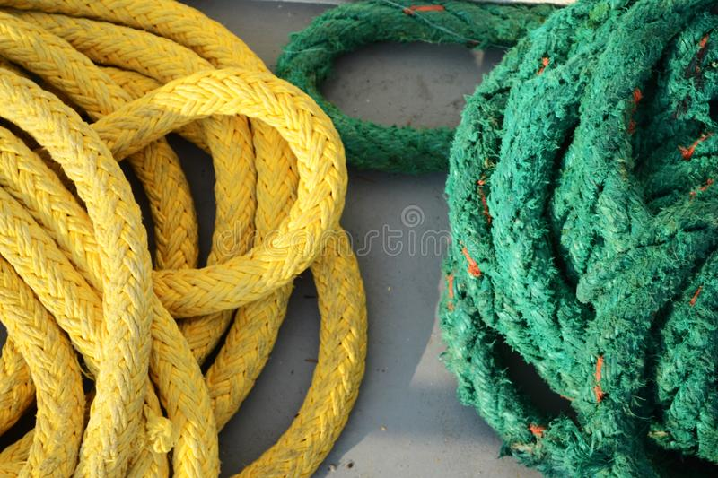 Yellow and green ropes. Used to tie ship to pier stock photos