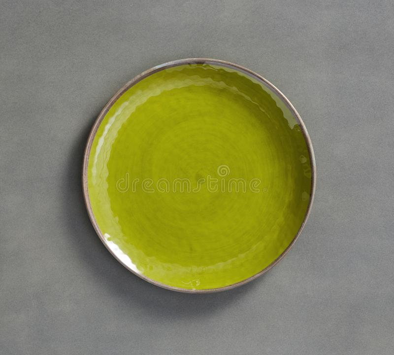 Yellow Green Swirl Melamine Plate with light gray background stock photography