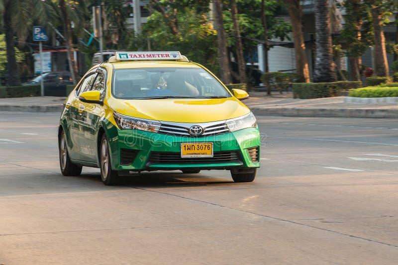 Yellow green taxi in bangkok stock images