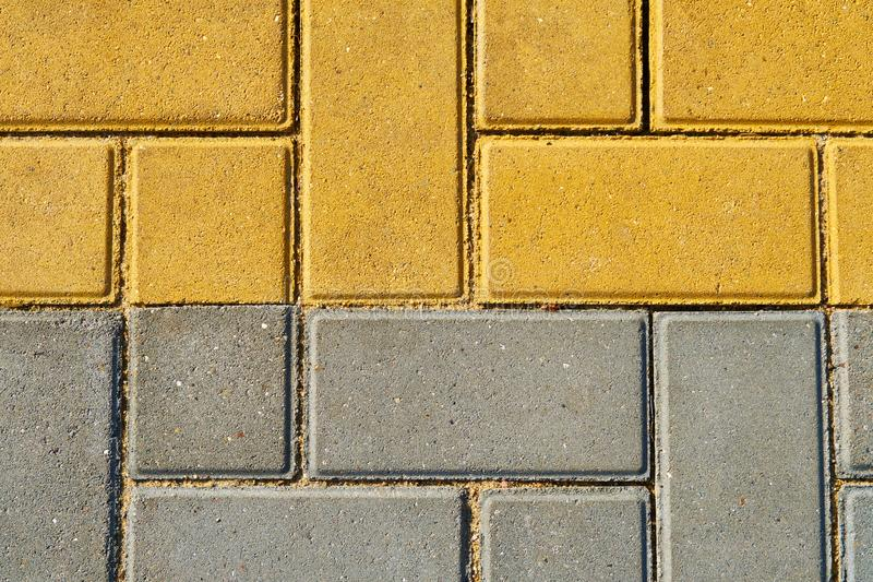 Yellow and grey paving tile for background or texture royalty free stock images