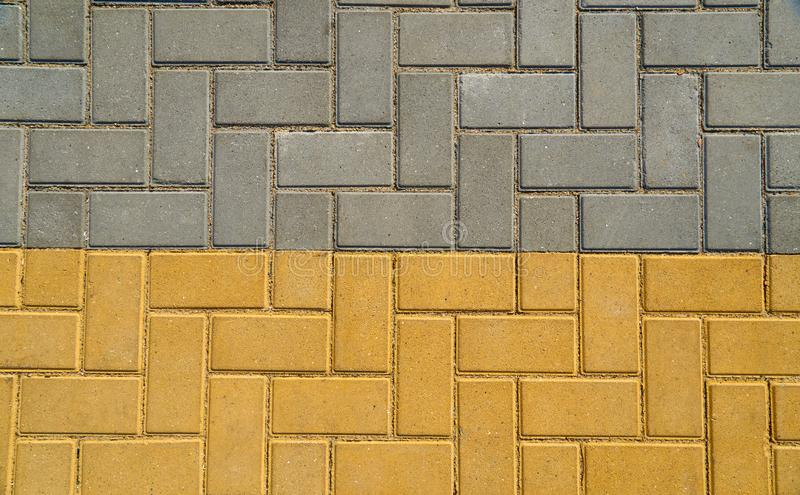 Yellow and grey paving tile for background or texture stock image