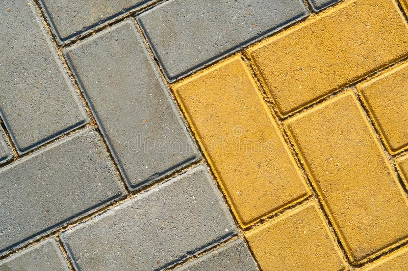 Yellow and grey paving tile for background or texture royalty free stock photo