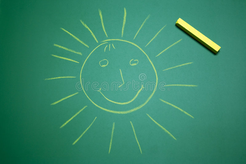 Yellow happy sun on school panel stock photos
