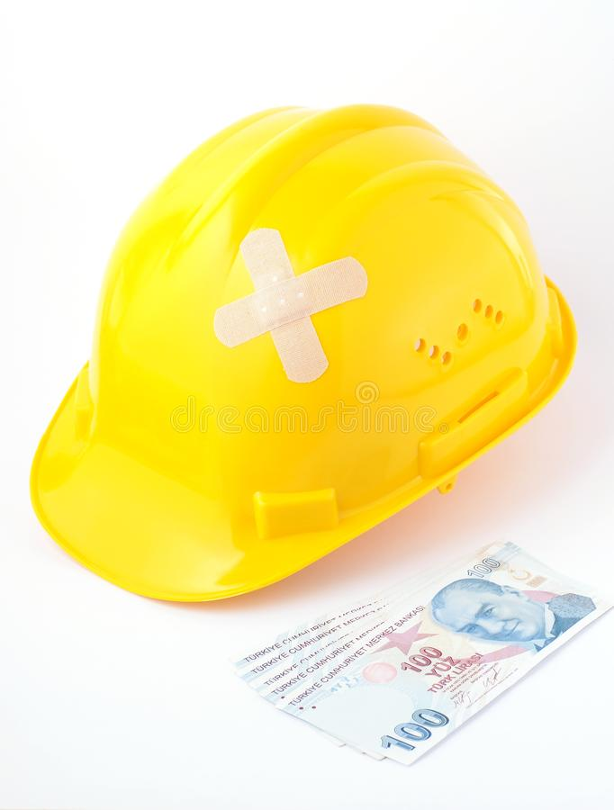 Yellow hard hat with plaster and Turkish lira stock image