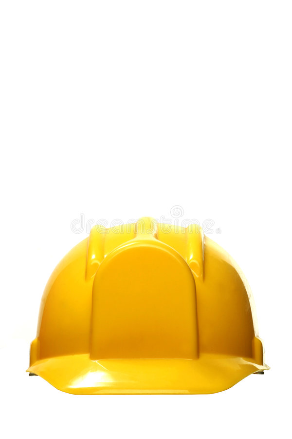 Yellow hard hat on white stock photography