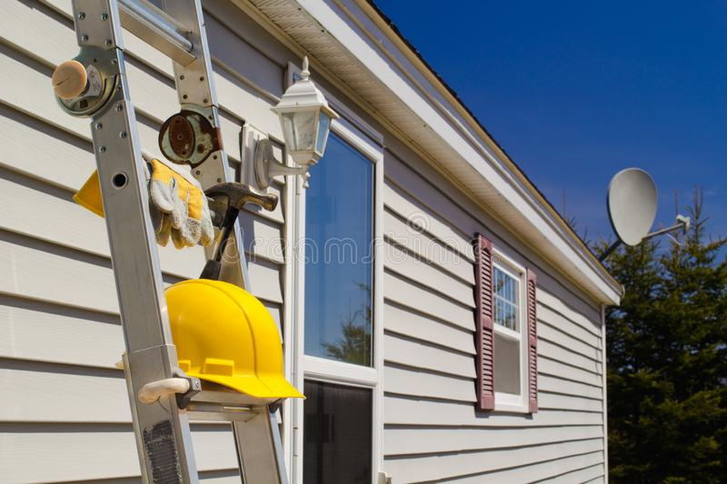 Ladder, Gloves, Hammer And Hard Hat royalty free stock image