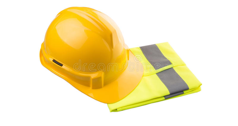 Yellow Hard Hat and Yellow Vest II. Yellow hard hat and yellow reflective best over white background stock image