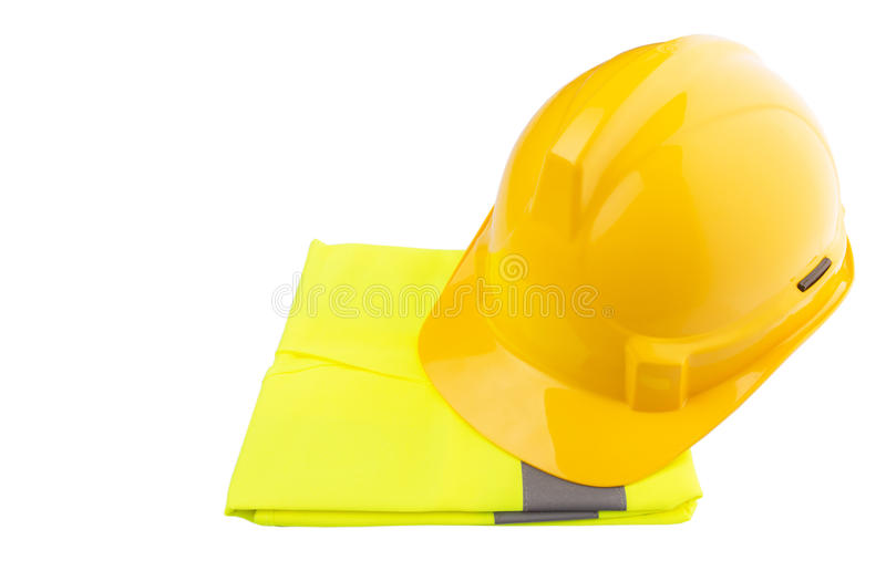 Yellow Hard Hat and Yellow Vest IV. Yellow hard hat and yellow reflective best over white background royalty free stock photo