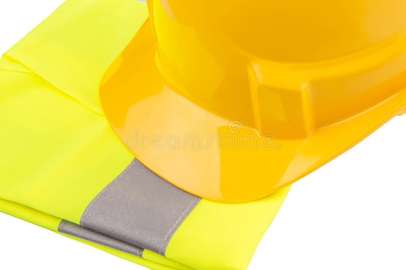 Yellow Hard Hat and Yellow Vest IX. Yellow hard hat and yellow reflective best over white background royalty free stock photos