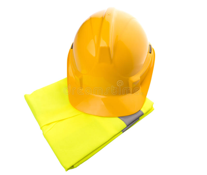 Yellow Hard Hat and Yellow Vest V. Yellow hard hat and yellow reflective best over white background royalty free stock photo
