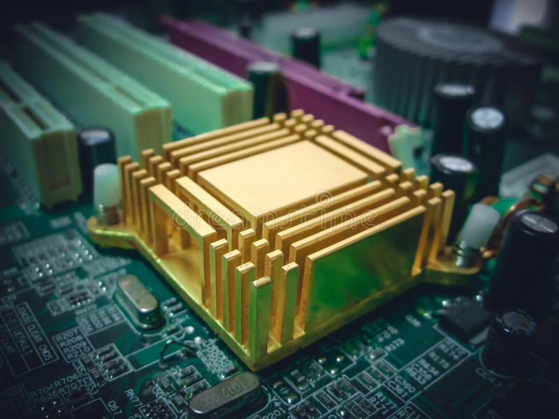 Yellow heat sink. On the motherboard is used to cool microprocessors royalty free stock photo