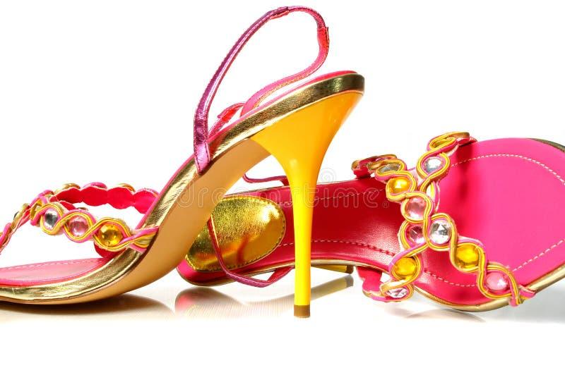 Yellow heels on white royalty free stock image