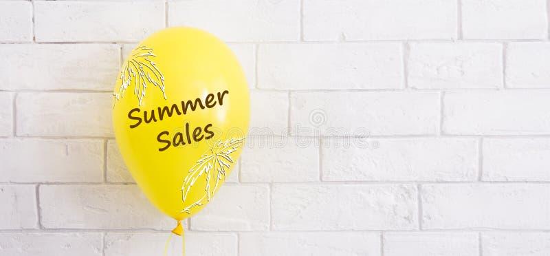Yellow hellium balloon with summer sale promotion stock photos