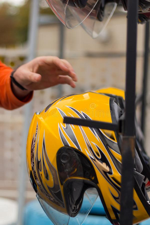 Yellow helmet on racing kart circuit after competition stock photography