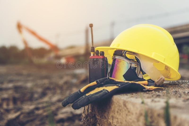 Yellow helmets, gloves, radio communication and safety glasses p royalty free stock photos